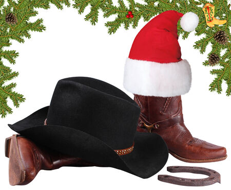 Santa red hat with cowboy boots.Christmas objects isolated on white