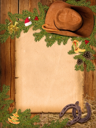 Christmas Western background with cowboy hat and old paper for text photo