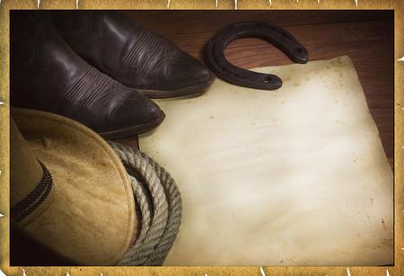 herradura: Fondo de vaquero con sombrero occidental y lazo y papel para el texto