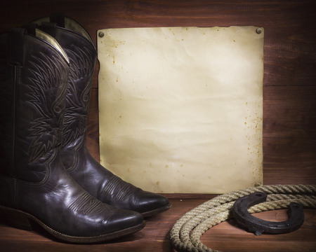 cowboy background with American boots and lasso and paper for text Standard-Bild