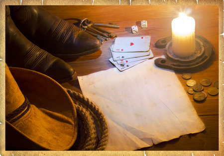 for text: American west background with poker cards and cowboy clothes.Old paper for text