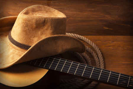 vintage music background: American Country music background with guitar and cowboy hat Stock Photo