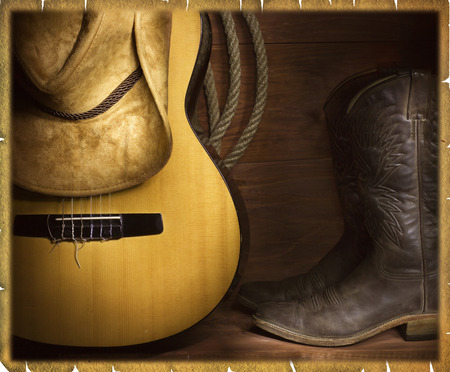 barn boots: Country music background with guitar and cowboy clothes Stock Photo