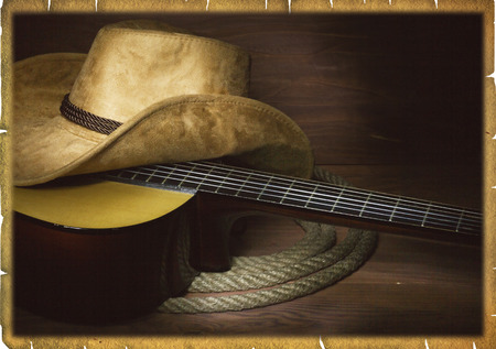 Country music background with guitar and cowboy hat