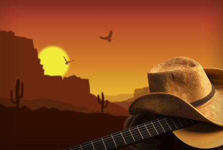 western clothing: Country music collage with guitar and cowboy hat . American landscape background Stock Photo
