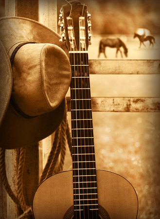 country landscape: American country music background with cowboy hat and guitar