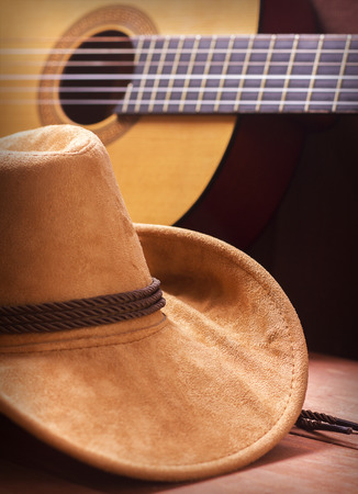music instrument: American Country music picture with cowboy hat and guitar