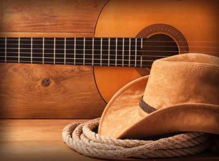 vaquero: Pa�s m�sica de fondo americano con sombrero de vaquero y lazo Foto de archivo