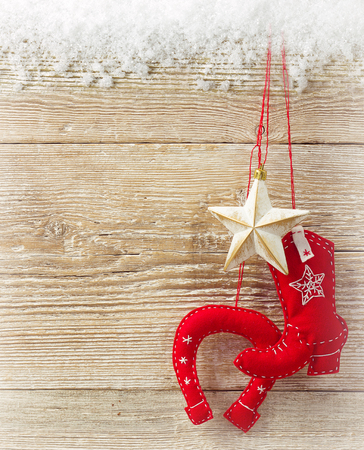 Christmas cowboy background with western toy boot and star on wood texture