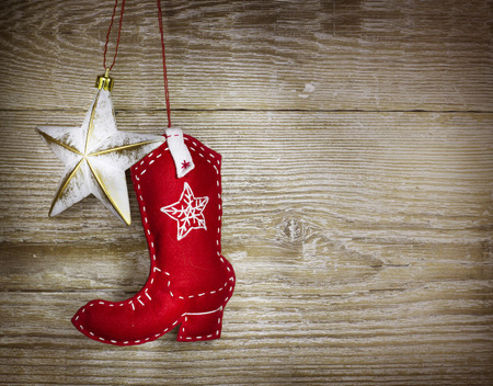 western: Cowboy christmas background with western toys boot and star on old wood texture