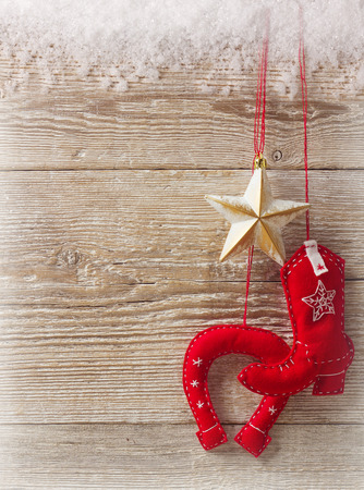 Cowboy christmas background on wood texture with handmade toys