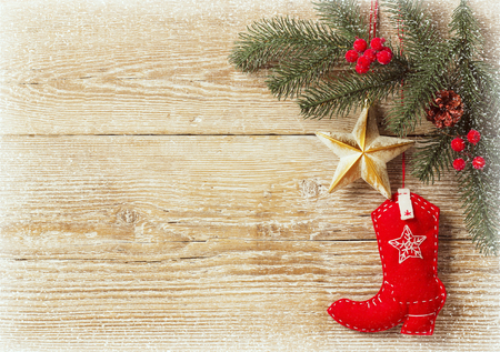 christmas background with cowboy shoe decoration toys.Wood texture for text Archivio Fotografico