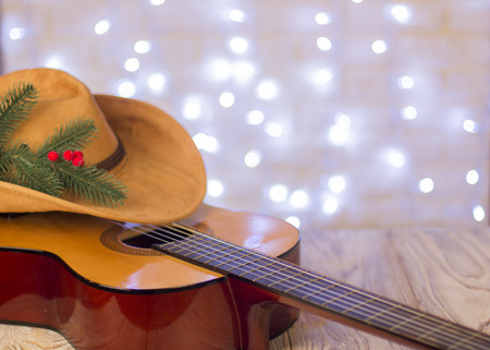 Christmas background.Country music with acoustic guitar and american cowboy hat Stock Photo