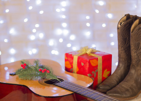 music christmas background with guitar and cowboy shoes Stock Photo