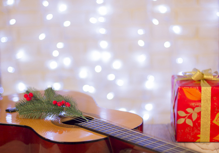 Christmas music background with guitar and red gift