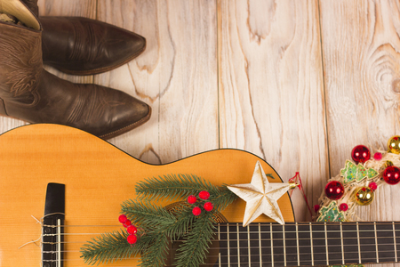 western cowboy christmas background with guitar and cowboy boots Stock Photo