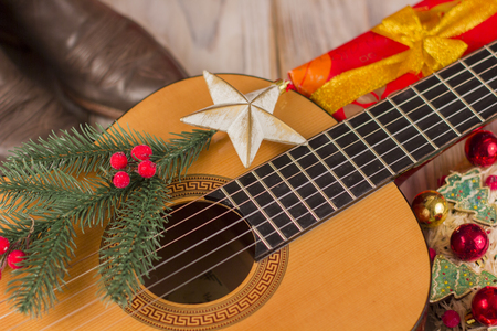 country music christmas background with acoustic guitar and cowboy boots stock photo 89885790 - Free Country Christmas Music
