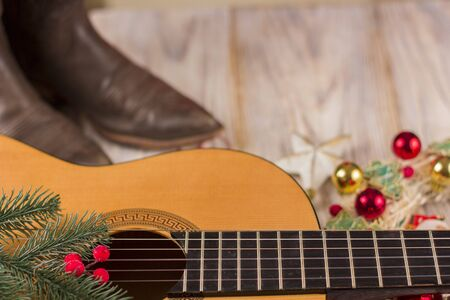 christmas music background for text with acoustic guitar and holiday decoration Stock Photo