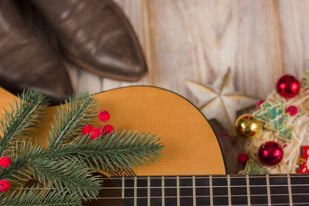 christmas music background with acoustic guitar and holiday wreath