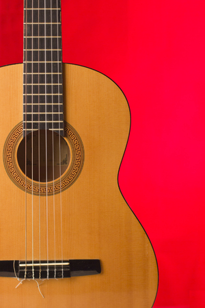 Acoustic guitar on red background for text