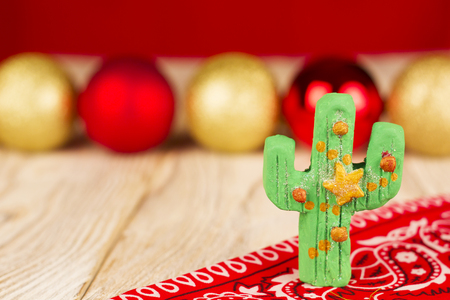 Holiday green cactus on christmas background for text