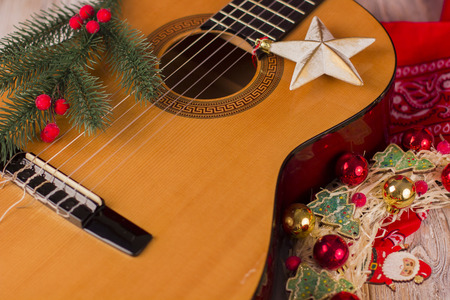Christmas music background with guitar and holiday winter decorations