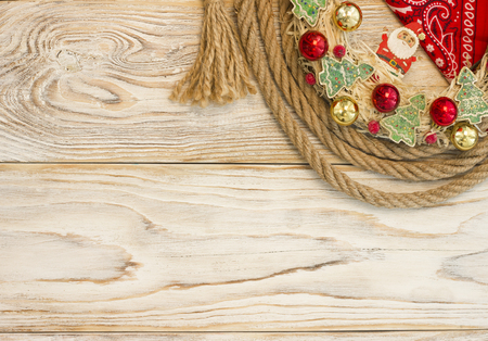 Wild American christmas background with christmas wreath and cowboy lasso on wood texture for text Stock Photo