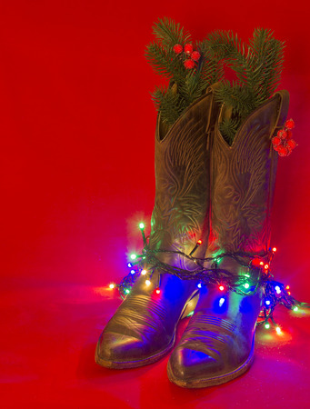 Cowboy American Christmas red background with West traditional boots Stock Photo