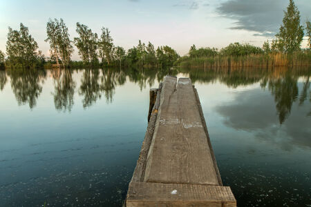 tier: wooden tier at the lake