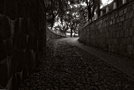 old city cobbled street in dusk Stock Photo