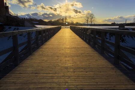 bridge over water: Bridge in the sunset Stock Photo