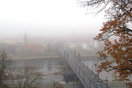 walpaper: city in the fog Stock Photo