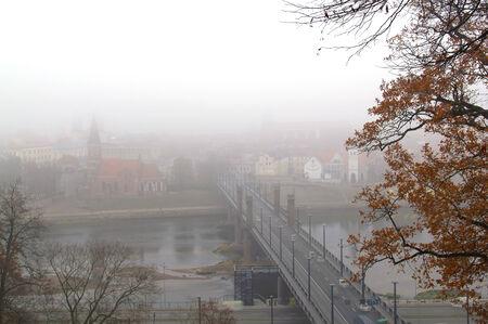 bridge over water: city in the fog Stock Photo