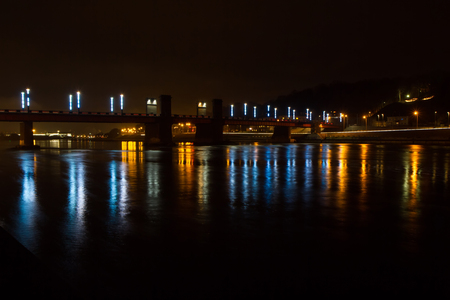 bridge over water: Bridge lights at night