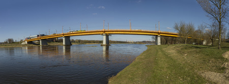 bridge over water: yellow bridge over the Neman Panorama Stock Photo