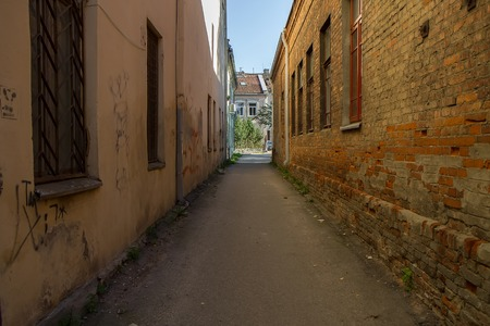 the passage: narrow passage between the old houses Stock Photo