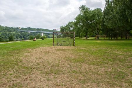 drilled: Football gateway near wild forest