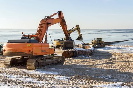 midday: excavator in sea