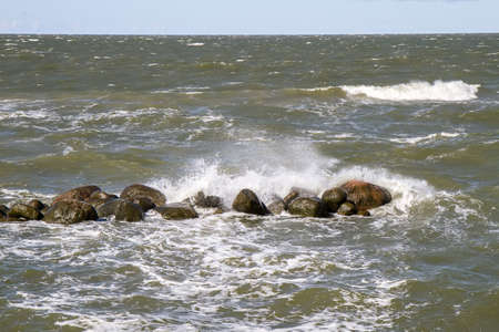 midday: stones in sea Stock Photo