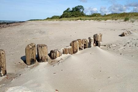 uninhabited: bridge remains on the sand Stock Photo