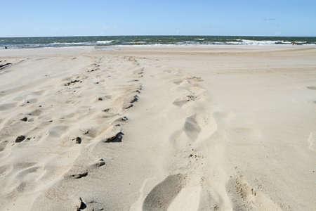 uninhabited: Feet in the sand