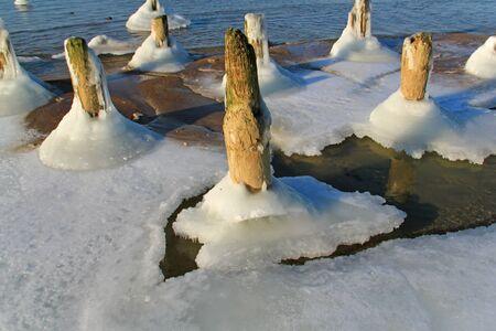 icy: Icy bridge piles Stock Photo