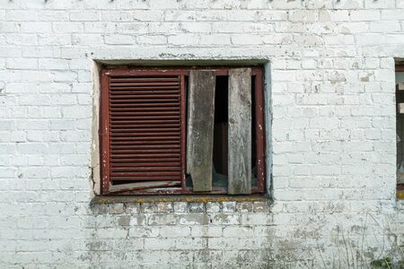 bombed city: boarded up window