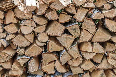 stacked: Lots of stacked firewood Stock Photo