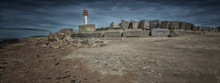 stacked stones: Lighthouse standing on the shore of the Baltic Sea