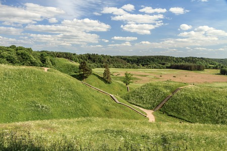 hay field: From Mounds To mounds Stock Photo