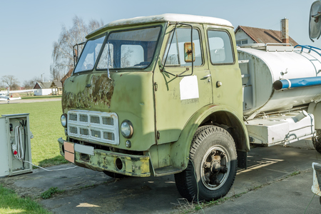 airplane ultralight: old Truck with fuel Stock Photo