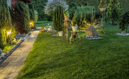 Garden illuminated by lamps panorama