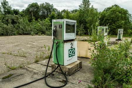 old service station: Old Gas station overgrown with bushes Stock Photo