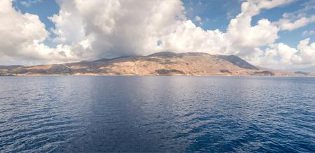Mountains in sea panorama Stock Photo